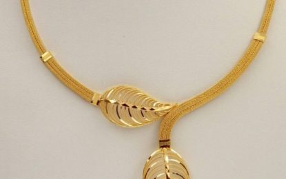 Top Three gold bangles and long chain design for a woman